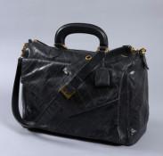 strong CHANEL, Rare sac de voyage vintage en cuir noir surpiqué à motif d541ae8483a