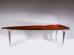 "Marc NEWSON (Né en 1963) Table dite ""Black Hole Chop Top"" - 2004 Piètement et structure en aluminium poli, aluminium laqué orange, p..."