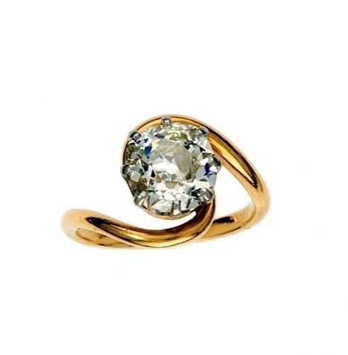 BAGUE TOURBILLON en platine et or jaune ornée d un diamant taillé à l  a7da83ddeb20