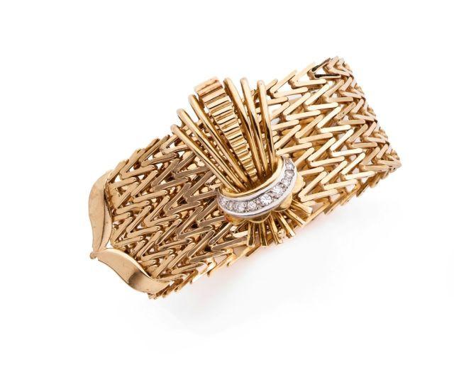 a160c54017d BRACELET LARGE en or jaune et platine formé d'un bandeau souple de type  ceinture