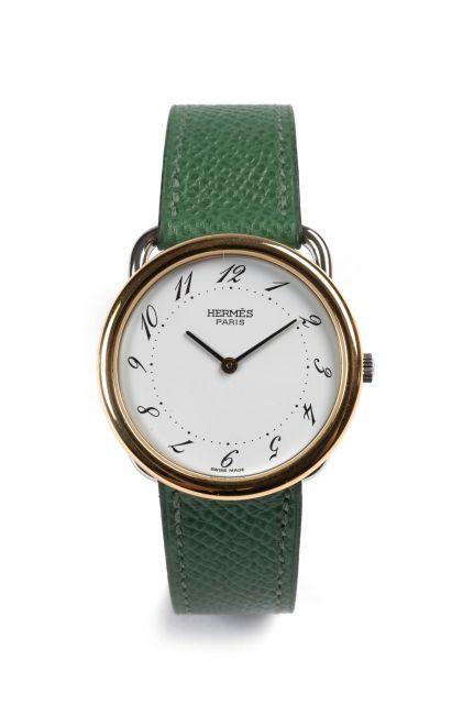 252d336ad7f HERMÈS Paris ARCEAU n° 1510643 vers 2000 Belle montre bracelet bicolore  acier et doré.