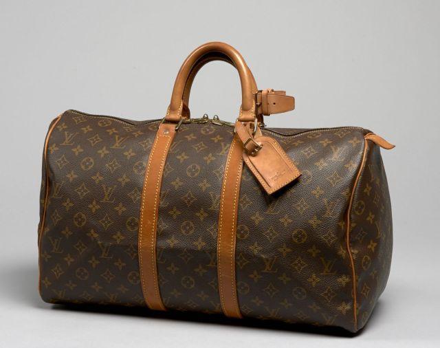 80c453badbd2 Louis VUITTON, Keepall 45 en toile Monogram et garnitures en cuir naturel.  Petites marques