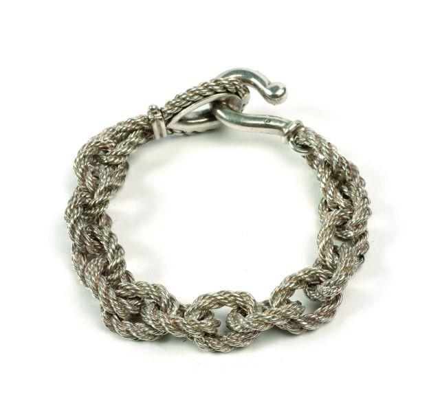 HERMES Bracelet en argent formé de seize maillons forçats torsadés, fermoir  (750). e6579296960