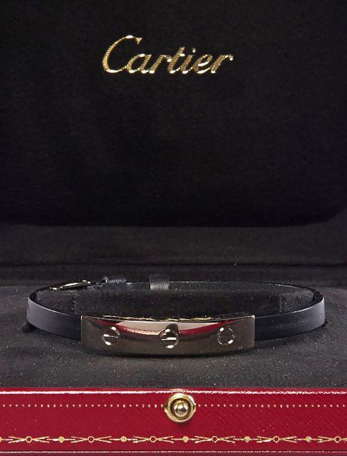 0ecae95972ce CARTIER, Bracelet Love en or blanc et cuir noir. Petites rayures mais bel  état