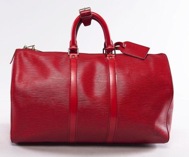 Louis VUITTON, Grand Speedy 45 en cuir épi rouge, intérieur au naturel,  porte 703fca5af5a