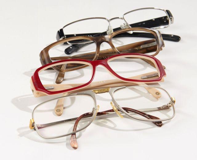 c6616a2932e11b CHANEL, Deux paires de montures de lunettes. PRADA, Une paire de monture de