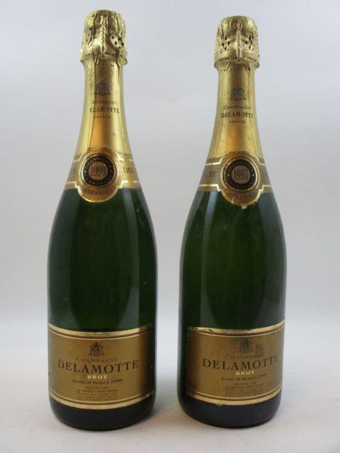 2 bouteilles CHAMPAGNE DELAMOTTE 1997 Blanc de Blancs (étiquettes abimées...