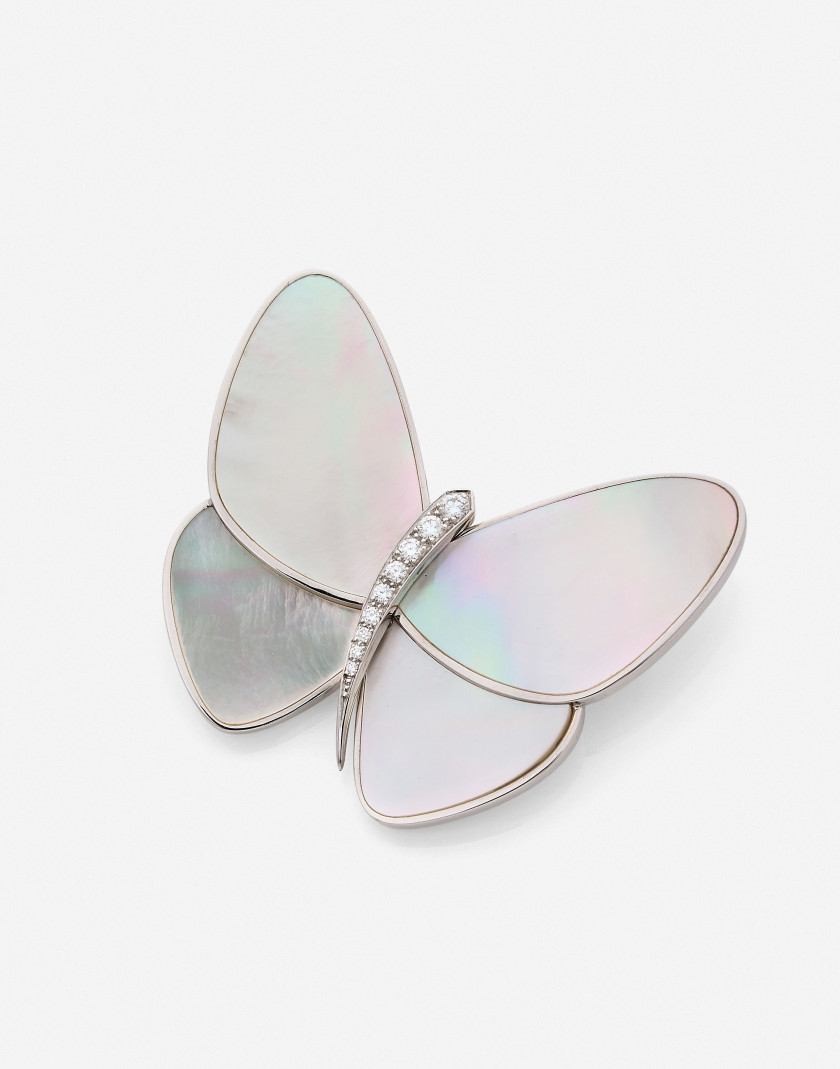 "VAN CLEEF & ARPELS  Clip ""Papillon"" or et nacre, certificat  A mother-of-pearl, diamond and gold ""Butterfly"" clip, certificate"